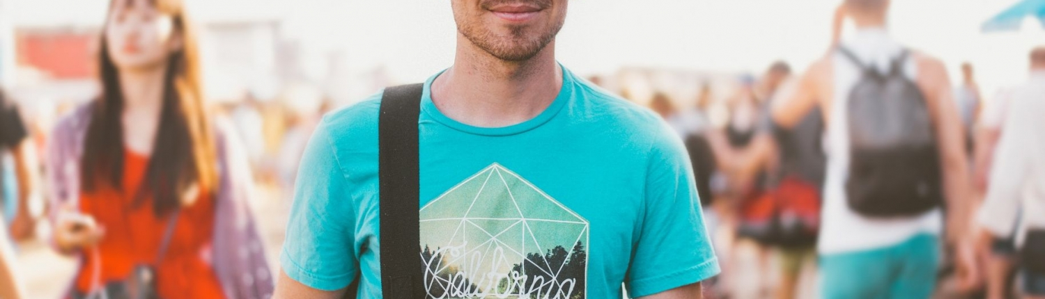 Man in T-shirt smiling after resolving hormonal and adrenal fatigue issues in Australia