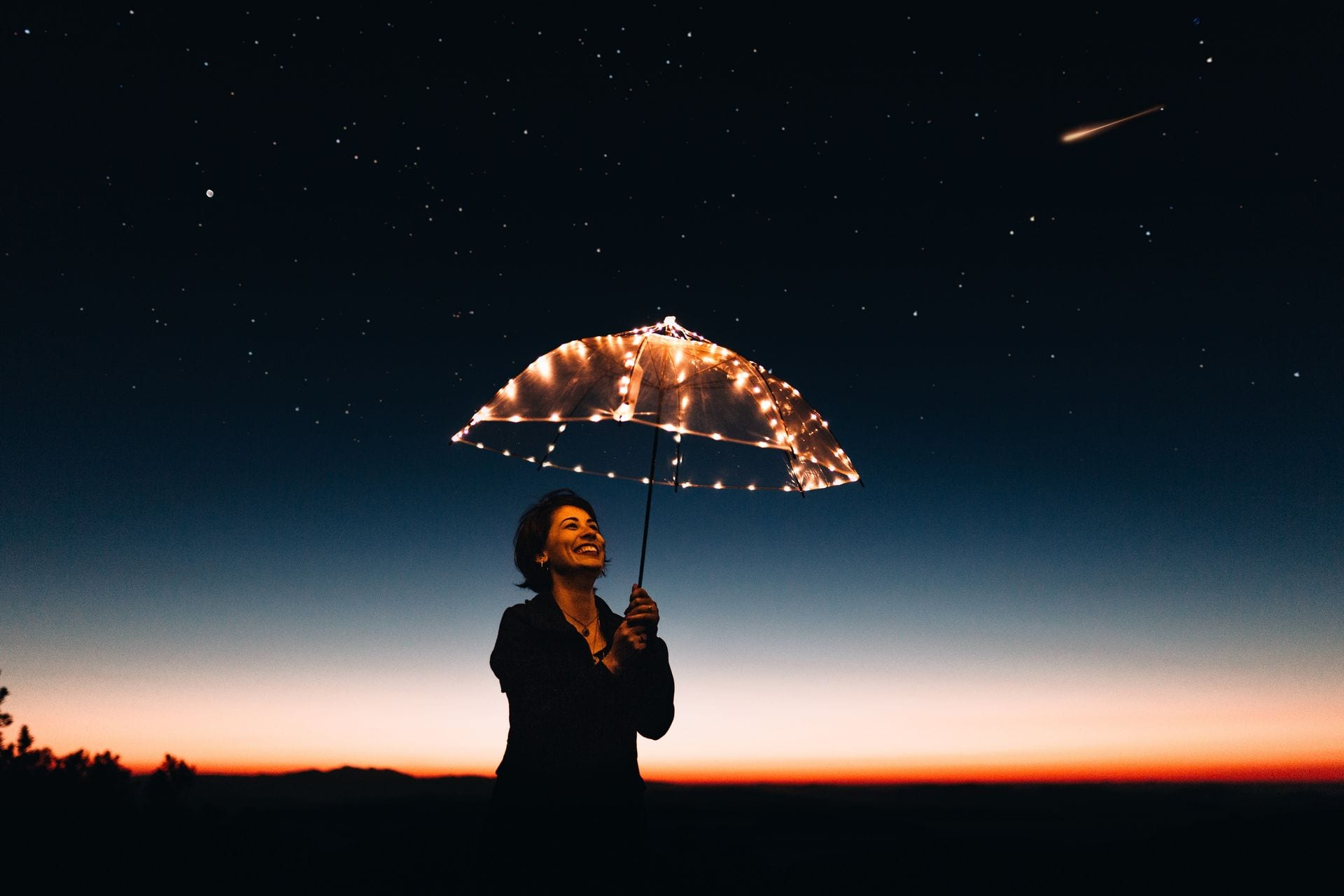 Woman with umbrella protected like you are with a Nutritionist and Functional Medicine practitioner