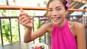 woman happily eating food